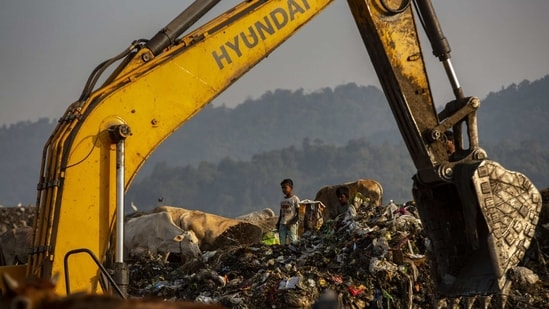 Imradul Ali, 10, looks for recyclable material at a landfill on the outskirts of Guwahati, India, Thursday, Feb. 4, 2021.(AP)