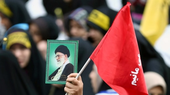 An Iranian protester holds the picture of Iranian Supreme Leader Ayatollah Ali Khamenei as she attends an anti U.S. demonstration in Tehran, Iran,(Reuters)
