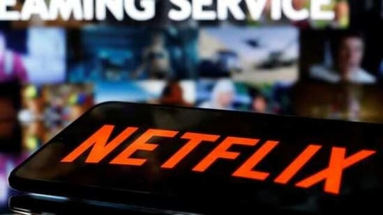 "FILE PHOTO: A smartphone with the Netflix logo lies in front of displayed ""Streaming service"" words in this illustration taken March 24, 2020. REUTERS/Dado Ruvic/Illustration/File Photo(REUTERS)"