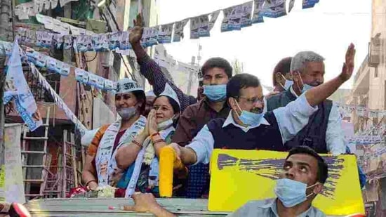 Delhi Chief Minister Arvind Kejriwal holds a roadshow in Shalimar Bagh area ahead of byelections in five wards of North MCD and East MCD in New Delhi on Wednesday. (ANI Photo)