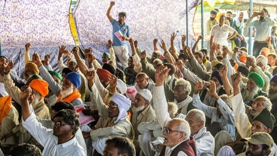 Farmers raise slogans during a protest against the new farm laws, at the Delhi-Ghazipur border in New Delhi on Thursday. (ANI Photo)