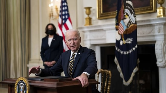 U.S. President Joe Biden in the State Dining Room of the White House in Washington, DC, US, on Wednesday, Feb. 24, 2021. Biden revoked a proclamation from his predecessor that blocked many green card applicants from entering US.(Bloomberg)