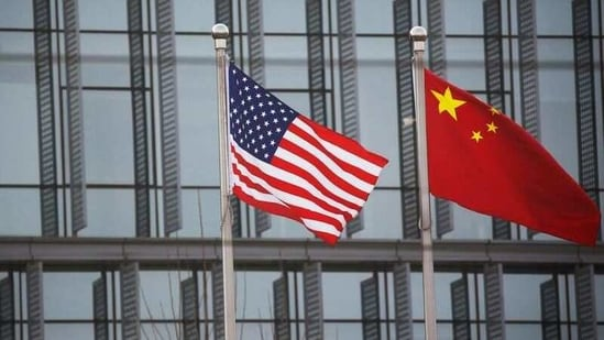 Chinese and US flags flutter outside the building of an American company in Beijing, China. (REUTERS)