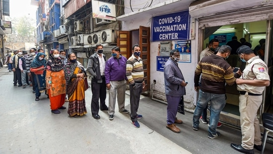 Frontline workers stand in a queue to receive their first dose of Covaxin in New Delhi.(PTI)
