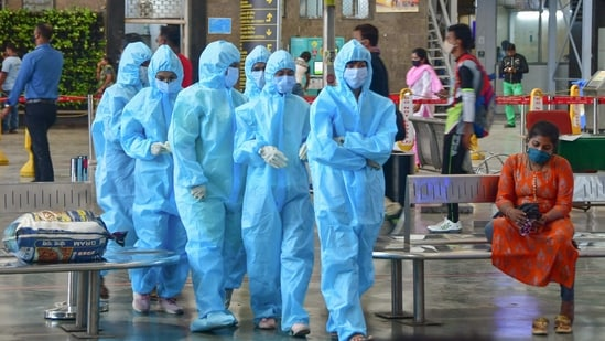 Healthcare workers arrive to screen passengers at the CSMT railway station, owing to surge in Covid-19 cases in Mumbai, on Friday.(PTI Photo)