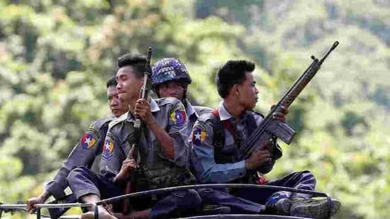 File photo of Myanmar police guarding a UN convoy.(Reuters)