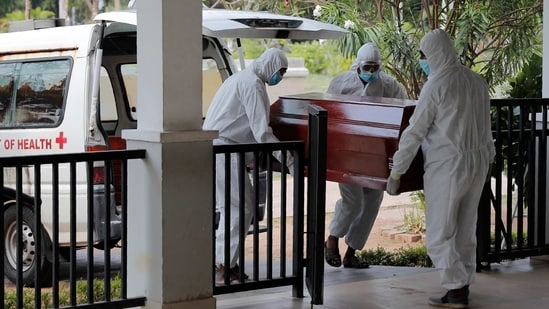 Sri Lankan health workers carry a coffin carrying remains of a COVID -19 victim to a cremation furnace in Colombo, Sri Lanka, Wednesday, Feb. 10, 2021. (AP Photo/Eranga Jayawardena)(AP)