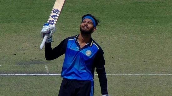 Prerak Mankad celebrates his century. (BCCI)