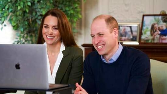 """In this undated handout photo provided by Kensington Palace on Saturday, Feb. 27, 2021, Britain's Prince William and Kate, Duchess of Cambridge smile during a video call to people with health conditions about the positive impact of the COVID-19 vaccine. The Duke of Cambridge has urged people to keep on taking the Covid-19 vaccination so """"younger generations"""" will feel """"it's really important for them to have it"""". (Kensington Palace via AP)(AP)"""