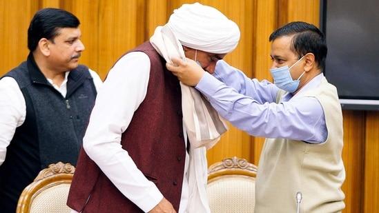 Delhi chief minister Arvind Kejriwal felicitates a farmer leader from Western Uttar Pradesh during a meeting at the Delhi Legislative Assembly in New Delhi on February 21. (ANI File Photo)