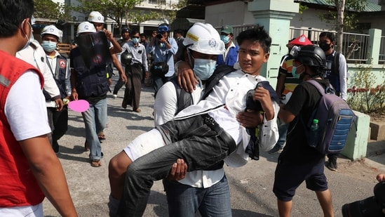 A wounded protester is carried during a protest against the military coup in Mandalay, Myanmar, Sunday.(AP)
