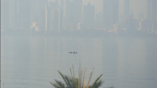 A fisherman in his boat in hazy weather off Bandra coast in Mumbai on Sunday. (Satish Bate/HT Photo)