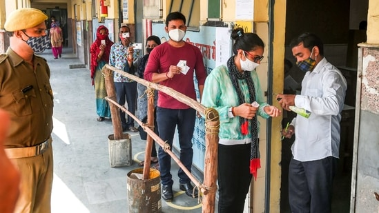 Thermal guns are being used to measure temperature of each voter and masks and sanitiser bottles being provided at polling stations, an official said.(PTI)