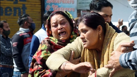 Distraught family members of Akash Mehra who succumbed to his injuries at a Srinagar hospital on Sunday. (ANI)