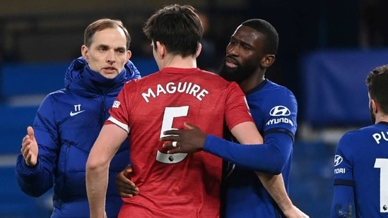 Chelsea's head coach Thomas Tuchel, left, Manchester United's Harry Maguire, centre, and Chelsea's Antonio Rudiger react after the English Premier League soccer match between Chelsea and Manchester United at Stamford Bridge Stadium in London, England.(AP)