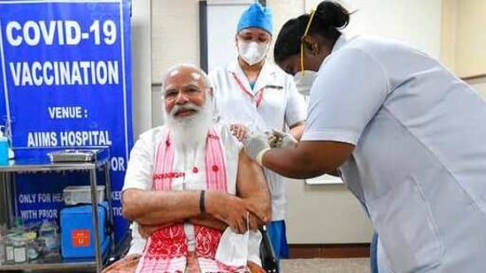 Indian Prime Minister Narendra Modi is administered a Covid-19 vaccine in New Delhi on Monday, March 1, 2021.(AP Photo)