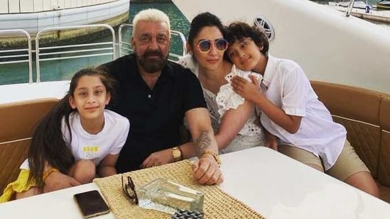 Sanjay Dutt poses with his family on a yacht.