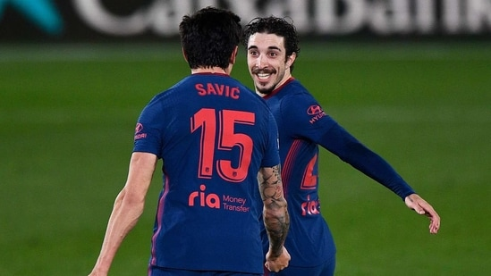 Atletico Madrid's Sime Vrsaljko and Stefan Savic celebrate their first goal, an own goal scored by Villarreal's Alfonso Pedraza.(REUTERS)
