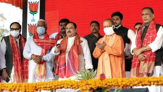 BJP President J.P. Nadda along with Uttar Pradesh CM Yogi Adityanath inaugurating the newly constructed regional office & Prayagraj Mahanagar Karyalaya, in Varanasi on Sunday. (ANI Photo)