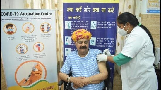 Punjab governor and UT administrator VP Singh Badnore was the first to get the jab at the dispensary in Sector 7, where only five people turned up. (HT Photo)