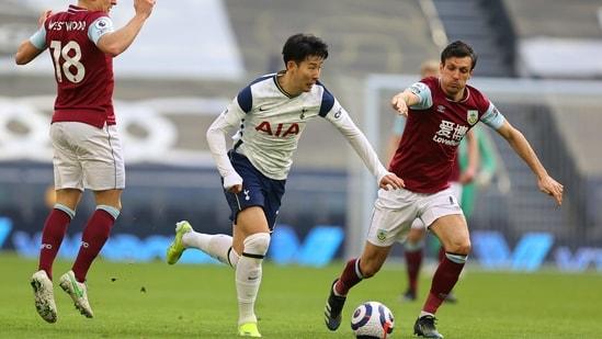 Tottenham's Son Heung-min, centre, runs with the ball during an English Premier League match.(AP)