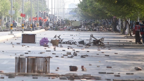Myanmar riot police clear the barricade to move forward during a protest against the military coup in Mandalay, Myanmar. (AP Photo)