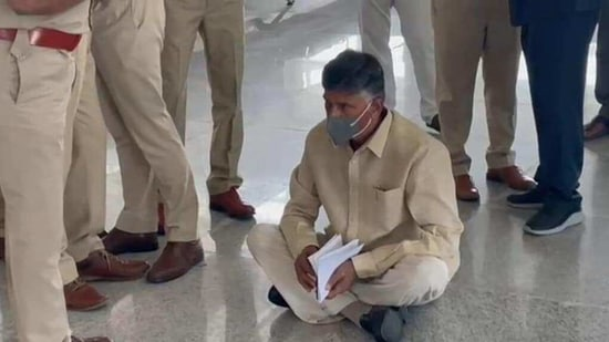 Chandrababu Naidu seen sitting on the airport floor in protest. (HT Photo)