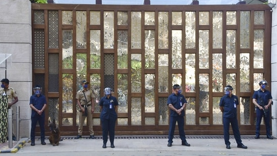 **EDS: RPT, CORRECTS TYPOS** Mumbai: Police personnel guard outside industrialist Mukesh Ambani's residence Antilla, a day after explosives were found in an abandoned car in its vicinity, in Mumbai on Friday, Feb. 26, 2021. (PTI Photo) (PTI02_26_2021_000163A)(PTI)