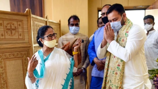 West Bengal Chief Minister Mamata Banerjee with RJD leader Tejaswi Yadav at State Secretariat, in Kolkata on Monday.(PTI)