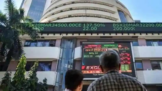 People watch the Sensex on a screen outside Bombay Stock Exchange (BSE) in Mumbai. (PTI File Photo )
