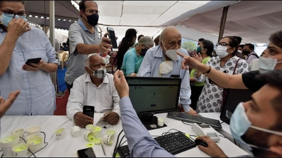 Senior citizens register to get their first dose of Covid-19 vaccine at BKC jumbo Covid centre in Mumbai on Monday. (Satish Bate/HT Photo)