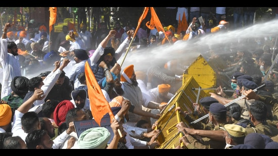 Police using water cannons against Shiromani Akali Dal workers during a protest march in Chandigarh on Monday. (Keshav Singh/HT)