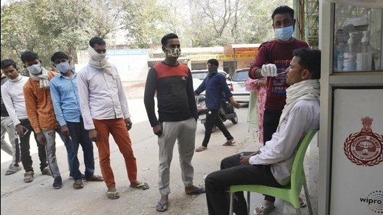 People giving swab samples at Civil Hospital as testing for Covid-19 increases due to a spike in cases around NCR, in Gurugram, India on February 28, 2021. (HT PHOTO)