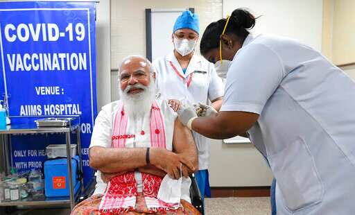 At the time of vaccination, PM Modi was seen sporting a traditional gamosa. (PMO)