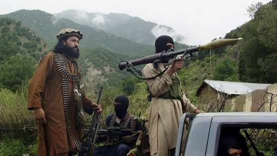Pakistani Taliban patrol in their stronghold of Shawal in Pakistani tribal region of South Waziristan in this file photo in this file photo from 2012. (AP Photo)