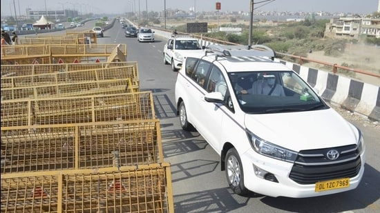 Vehicles move towards Ghaziabad after the road connecting it with Delhi via Ghazipur reopened for vehicular movement, since its closure following clashes between police and farmers on January 26 in New Delhi, Tuesday. (PTI)