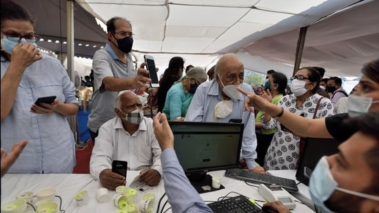 Senior citizen registering to get their first dose of a Covid-19 vaccination, at BKC in Mumbai, India, on Monday, March 1. (Satish Bate/HT Photo)