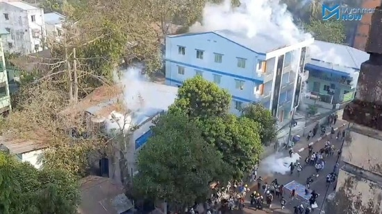 """""""If we're oppressed, there will be explosion. If we're hit, we'll hit back,"""" demonstrators chanted before police moved in firing stun grenades to scatter crowds in at least four different places in the city.(MYANMAR NOW via REUTERS)"""