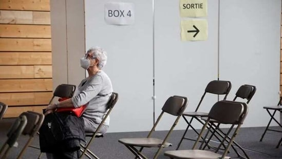 A patient waits at a coronavirus disease vaccination center installed inside a gymnasium in Taverny near Paris.(Reuters)