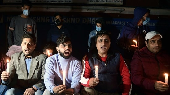 Civil society members and corporators from Srinagar during a candle light protest outside Krishna Dhaba, whose owner's son Aakash Mehra succumbed to injuries, 11 days after he was shot.(ANI)
