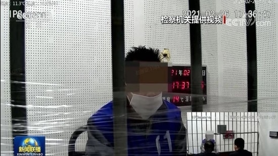 A screenshot from the video telecast by state media showing the confession of a blogger, identified as Qiu, arrested for allegedly insulting PLA soldiers online. (CCTV/SCREENGRAB)
