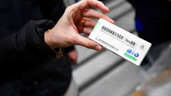 A woman holds a packet containing vials of the COVID-19 vaccine developed by the Chinese state-owned company Sinopharm at a Hungarian pharmaceutical wholesaler in Budapest, Hungary, Tuesday, Feb. 16, 2021. A shipment of COVID-19 vaccines produced in China arrived in Hungary on Tuesday, making it the first of the European Union's 27 nations to receive a Chinese vaccine. (Marton Monus/MTI via AP)(AP)