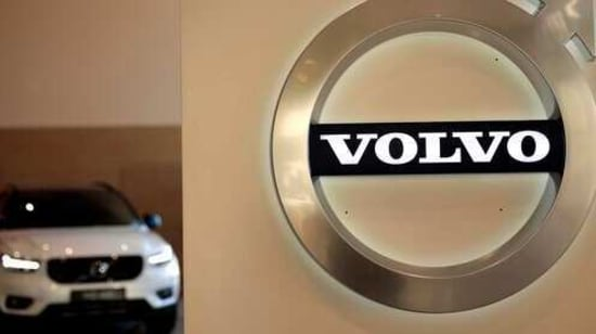 FILE - In this Feb. 6, 2020 file photo a Volvo car is parked behind the Volvo logo in the lobby of the company's corporate headquarters, in Brussels. Volvo says it will make only electric vehicles by 2030. But for those who want one, they will have to buy it online. The Swedish automaker said Tuesday, March 2, 2021, that it is phasing out the production of all cars with internal combustion engines — including hybrids. (AP Photo/Virginia Mayo, File)(AP)