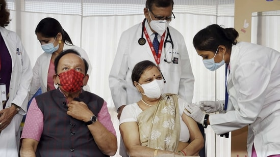 A medic administers the first dose of COVID-19 vaccine to Nutan Goel, wife of Union Health Minister Dr Harsh Vardhan during the second phase of a countrywide inoculation drive, at Delhi Heart and Lung Institute in New Delhi, (PTI)