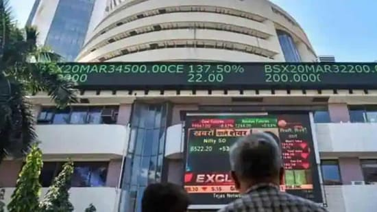 People watch the Sensex on a screen outside Bombay Stock Exchange (BSE) in Mumbai. (PTI)