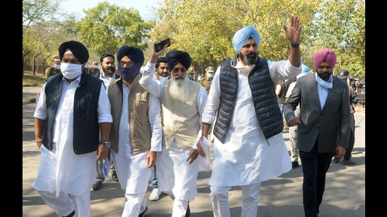 Senior Akali Dal leader Bikram Singh Majithia along with the other SAD leaders entering the Punjab Vidhan Sabha building to attend the second day of the Budget session in Chandigarh on Tuesday. (Ravi kumar/ht)
