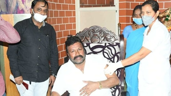The photo of Karnataka minister BC Patil getting Covid-19 vaccine at home was widely shared on social media.(ANI)
