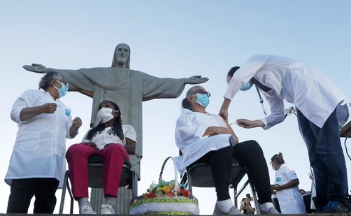 Terezinha da Conceicao, 80, left, and Dulcinea da Silva Lopes, 59, get vaccinated in front of the Christ the Redeemer statue in Rio de Janeiro, Brazil. Data in recent weeks on new variants from South Africa and Brazil has undercut optimism sparked late last year by two vaccines with around 95% efficacy against Covid-19. (AP Photo)