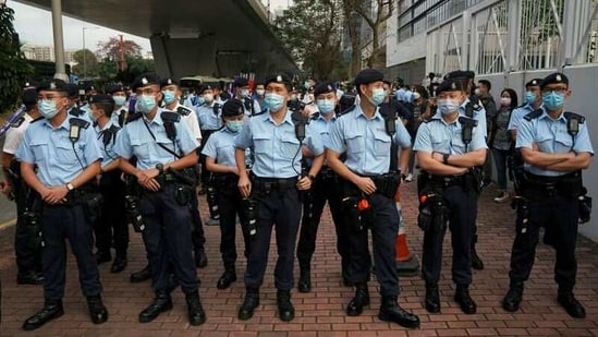 Police officers stand as supporters of pro-democracy activists facing charges related to national security gather outside West Kowloon Magistrates' Courts, in Hong Kong, China March 1, 2021. REUTERS/Lam Yik(REUTERS)