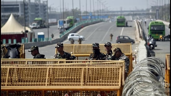 Security personnel stand guard during the ongoing farmers' protest at Ghazipur Border, in New Delhi on March 1. (ANI)
